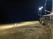 Women with the veil on the beach of Las Canters at 2AM